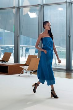 13. Wrapover dress in cotton chambray, wide-legged pants in cotton denim and heeled open sandals in leather