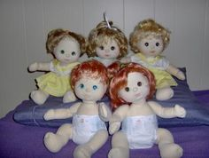 My Child dolls from the 80's.  Mine is the one on the top right. Oh my word! I forgot all about these!