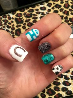 Country girl nails. Love the turquoise and hooey! Took awhile but so worth it(: #cowgirl #horseshoe #hooey