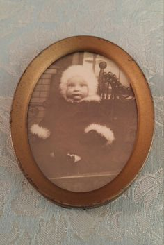Vintage mini photo, framed photo of baby, metal oval framed postcard, vintage postcard, baby in fur hat coat, baby picture in vintage frame by TheRustyWanderer on Etsy
