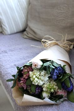 There is nothing prettier than a bouquet of spring blooms wrapped with a brown paper and a twine.