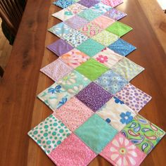 This table runner is so easy to make. It's lovely in colors for any season. See more examples and get the pattern here: http://quiltingdigest.com/this-zig-zag-runner-is-so-easy-to-make/