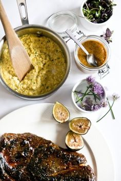 Grilled Pork Steaks with Sweet Corn Pudding and Fig Mustard recipe by Chef Michael Gulotta of August in New Orleans. Photo by Rush Jagoe.