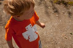 Teddybots logo t shirt in astronaut orange. for more info check out our toys and products on our website