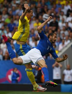 Sweden's forward Zlatan Ibrahimovic jumps with Italy's defender Giorgio Chiellini during the Euro 2016 group E football match between Italy and...