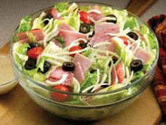 This simple antipasto salad is sure to hit the spot. Its filling blend of sausage, pitted ripe olives, tomatoes, and romaine lettuce offer a tasty but healthy meal. Find more National Hot Dog and Sausage Recipes online. Photo Via: Business Insider Anti Pasta Salads, Fast Food Salads, Italian Dressing Recipes, Italian Recipes, Jets Pizza, Party Salads, Salad Recipes, Healthy Recipes, Salads For A Crowd