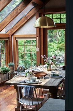 I love the contrast between the modern light fixture and the exposed wood beams and table and chair set. This is such an awesome breakfast nook! I want to eat here.