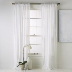 I will get white long curtains that will touch the ground. I will get two sets for 2 windows in the bedroom. $24.99 per curtain set. http://www.westelm.com/products/crinkle-cotton-window-panel-r805/?pkey=cwindow-panels-curtains-shades