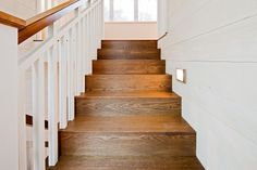 Lighting!  white rails instead of little thin peices... stairs all wood, railing white... Railing and beautiful stair stain... railing style... Love the railing... rail on wall... wood railing... Rail and bannisters... square railing... stained stairs, white railing... Railing and wood stairs... Stair railing... stairs - railing !... Stair treads and hand