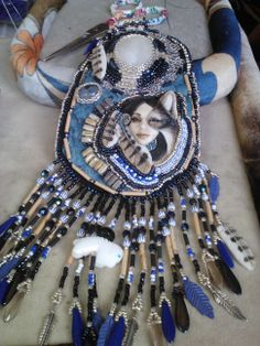 By RockNRoses  Laura Mears Shapeshifter Porcelain focal Moonstone, Montana Agate, Fish skin leather, filigree, seed bead embroidery.