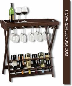 """Howard Miller 6-Bottle Wine wooden Table.  Accessories Wine bottle holder - Wine rack      655153 Havana        Cherry finished butler-style wine table. Removable serving tray top with protective black melamine laminate surface.  Wood stemware rack for 10 wine glasses.  Folding bottom rack holds up to 6 bottles of wine.  Easily folds for convenient storage.  Height: 34-3/4"""" (88 cm)  Width: 31"""" (81 cm)  Depth: 16"""" (41 cm)"""