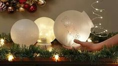 Plastic globes from the dollar store!! Stick some Christmas lights on them battery powered BAM!