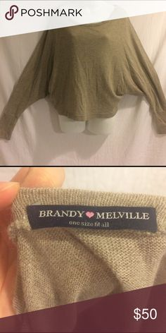 "Brandy Melville OS Sweater Brandy Melville light brown sweater. Baggy in armpits. Size: ""One size fit all"". Measurements: armpit to armpit: hard to measure. Shoulder to end of sleeve: 28.5"". Shoulder to bottom: 24"". All measurements approximate. In good condition. Brandy Melville Sweaters Crew & Scoop Necks"