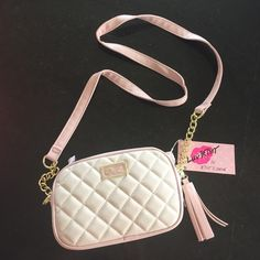 Betsey Johnson crossbody Luv by Betsey Johnson crossbody bag.  Cream with blush trim, gold hardware, tassel.  Double zip compartments.  NWT Betsey Johnson Bags Crossbody Bags