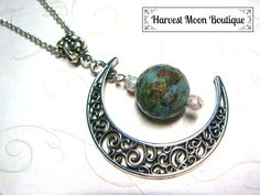 """This necklace was handcrafted by me. I used a silver plated filigree crescent moon charm and added silver plated stardust beads and a beautiful ruby in fuchsite bead. The pendant hangs almost 2.5"""" and comes on your size of antique silver plated link chain."""