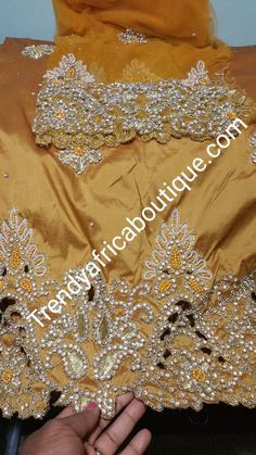 Nigerian Traditional wedding hand stoned Gold George Wrapper and matching net blouse.
