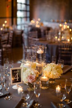 Romantic Floating Candle and Hydrangea Centerpieces   Jessica Haley Photography   http://knot.ly/6490BF7i4   http://knot.ly/6491BF7if