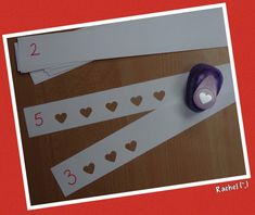 Valentine's Day cognitive development - punching hearts preschool activity