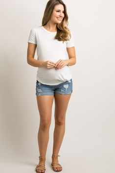 b0437d6936ea1 A pair of maternity denim shorts with distressed details, a cuffed hem, 5  pockets, and an elastic waistband. Material has high stretch.