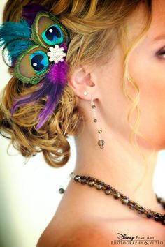 This Disney bride added a fabulous peacock feather hair accessory to her bridal ensemble.