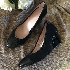 Black Taryn Rose wedge pumps suede Beautiful suede pumps by Taryn Rose. All day breathe ability, perforated suede upper. Super comfortable wedge heel. Very beautiful and elegant, dress up or down. Taryn Rose Shoes Heels