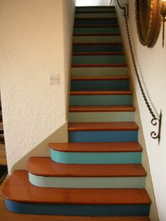 idea for painting the stairs - Red, Olive, Maize, and Black would work really well in my house!