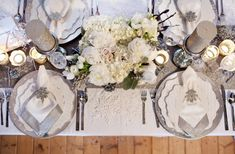 My color scheme is Champagne, Silver and Blue. I would love to use some of these ideas to incorporate silver on the tables.