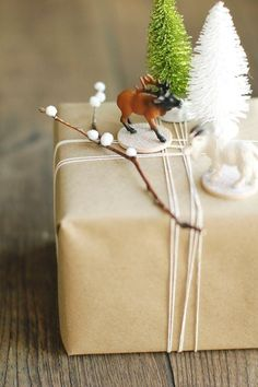 9 Inexpensive DIY Gift Wrapping Ideas | It's hard to deny that a beautifully wrapped gift, sitting under the tree or anywhere else, brings a certain pleasure. it's also hard to justify spending a lot of money on gift wrap when you know it's just going to get torn up and thrown away (or recycled!) in a few days. That's why we've rounded up these 9 inexpensive DIY gift wrapping ideas — ways you can make your packages look like a million bucks without spending, well, a million bucks…