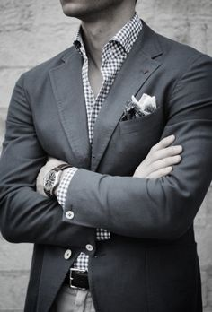The Modern Gentleman wearing two pocket squares in one pocket but it looks very smart and details the suit perfectly.