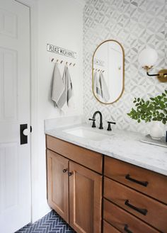 Modern Farmhouse Bathroom Renovation: Gorgeous wooden vanity with carrara marble countertop and mid century style knobs and pulls from Schoolhouse electric. This bathroom also features a blue herringbone tile floor and marble mosaic tile backsplash. Bathroom Renos, Small Bathroom, Dream Bathrooms, Master Bathroom, Bathroom Showers, Guest Bathroom Remodel, Restroom Remodel, Tub Remodel, Shiplap Bathroom