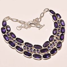 Add an elegant touch of sparkle to a special evening with this stunning necklace. Featuring Amethyst in a very unique design, in a .925 sterling silver setting for the ultimate in glamour. Very...@ artfire