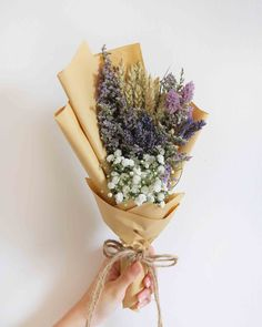 Well, let's start off with something basic like dried lavenders, dried Caspia, dried Wheat and some baby's breath that will dry up nicely. Good as a table decoration. Rough Dimensions: 25cm (H) x 15cm (W)