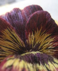2 of 2  Close up of the centre of the long and short pansy.  Margaret Dier Embroidery