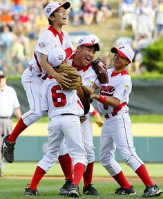 Pictures of the Year - Japan players celebrate after winning the Little League World Series against California. Japan won 6-4.