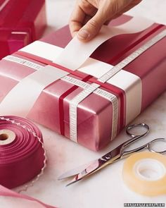 Woven Ribbon Wrap-Here's our idea of thinking outside the box: interweaving ribbons to dress up a gift. The weaving begins with a single ribbon stretched across the top of the package, its loose ends fixed to the bottom with double-sided tape. www.marthastewart.com