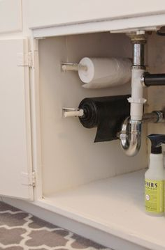 Use a paper towel roller to dispense garbage bags in an organized and streamlined fashion.