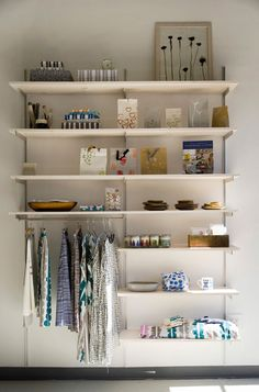 Really nice idea for a closet space. Or would even be nice in an entry way. Rod that the clothes are hanging on can be bought from Ikea for around eight bucks
