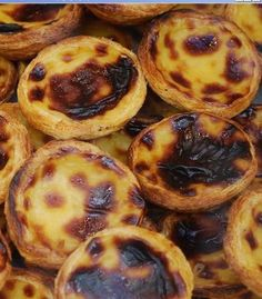"They were named ""pasteis de nata"", a crusty cape with a yummy inside, dont forget the cinnamon on top."