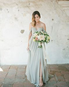 #sarahseven has stolen our #hearts again! #stormy #blue is a refreshing change and couldn't look lovelier. See more of these stunning looks at @ivorywhiteboutique #wedding #dress #wctakeover Xoxo @weddingchicks