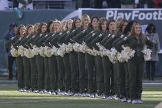 New York Jets cheerleaders stand during the singing of the national anthem before an NFL football game against the Miami Dolphins Sunday, Nov. 29, 2015, in East Rutherford, N.J. (AP Photo/Julie Jacobson)