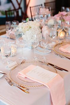 Pink Linens with Gold and White Accents on Reception Tables | Brides.com
