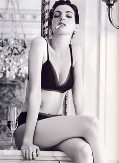 woman and cigarettes.  criminal Beauty  Anne Hathaway