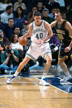 Bruno Sundov #40 of the Dallas Mavericks handles the ball against Zan Tabak #55 of the Indiana Pacers circa 2000 at Reunion Arena in Dallas, TX.