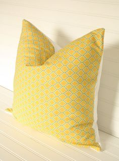 This etsy shop has tons of cute yellow and grey pillow covers!
