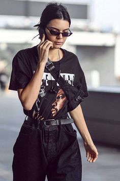 Kendall Jenner wearing Vintage 1990s Ice Cube T-Shirt, Balenciaga FW 17 Sunglasses, Beats by Dre BeatsX Headphones #kendalljenneroutfits
