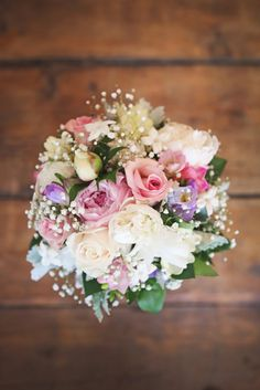 Everything about this bouquet is sweet.  Photo by K. Thompson Photography www.kthompsonphotography.ca www.fb.com/kthompsonphotography.ca #BarnWedding #CountryWedding #RusticWedding #WeddingDay #Wedding #Bouquet #Flowers #Pastels #BabiesBreath #Pink