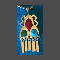 Gold and Turquoise Pendant by Watson Honanie