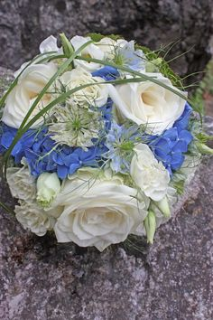 bridal  bouquet from white roses, blue hydrangeas, lysanthus, clematis and grasses, #wedding venue #wedding abroad #Bavaria #Riessersee