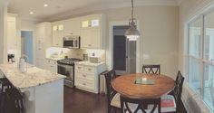 This #kitchen opens to a cozy little breakfast nook. The Runnymeade #1164. http://www.dongardner.com/house-plan/1164/the-runnymeade. #BreakfastNook #HomePlan