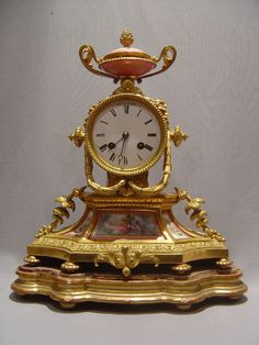 French antique pink porcelain and ormolu mantel clock. ca.1880.